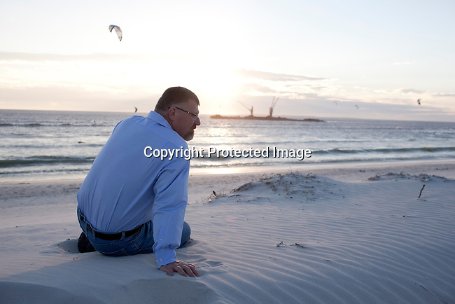 CAPE TOWN, SOUTH AFRICA MARCH 21: The author Deon Meyer posed for portraits on March 21, 2011 at Blouberg Strand beach, about 20 kilometers outside Cape Town, South Africa.  Mr. Meyer is a top-selling South African crime thriller author, whose books have been translated into 25 languages. Photo by Per-Anders Pettersson