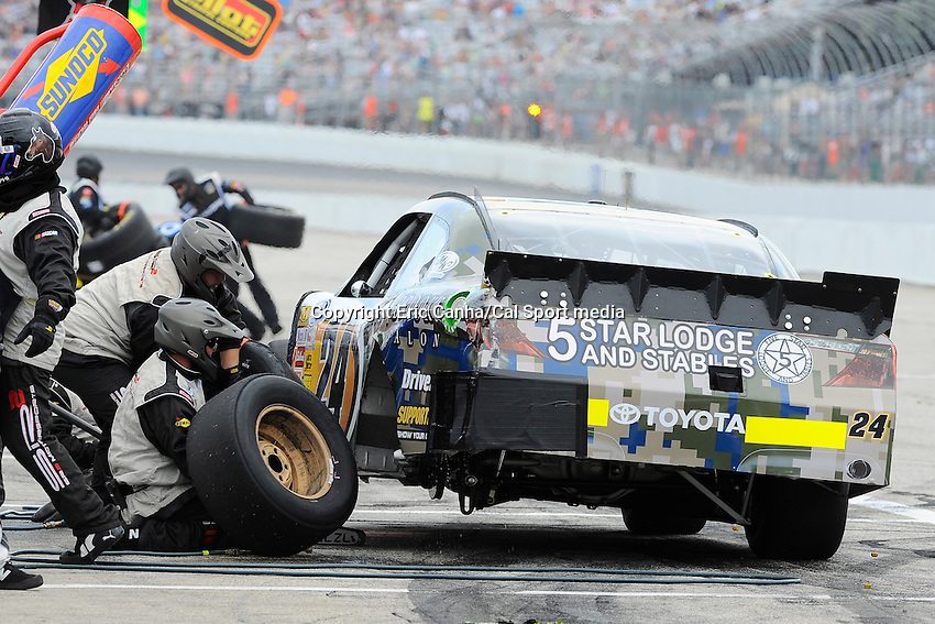 "July 13, 2013 - Loudon, New Hampshire U.S. - Nationwide Series driver Brett Butler (24) makes a pit stop while racing in the NASCAR Nationwide Series CNBC Prime's ""The Profit"" 200 race being held at the New Hampshire Motor Speedway in Loudon, New Hampshire.   Eric Canha/CSM"