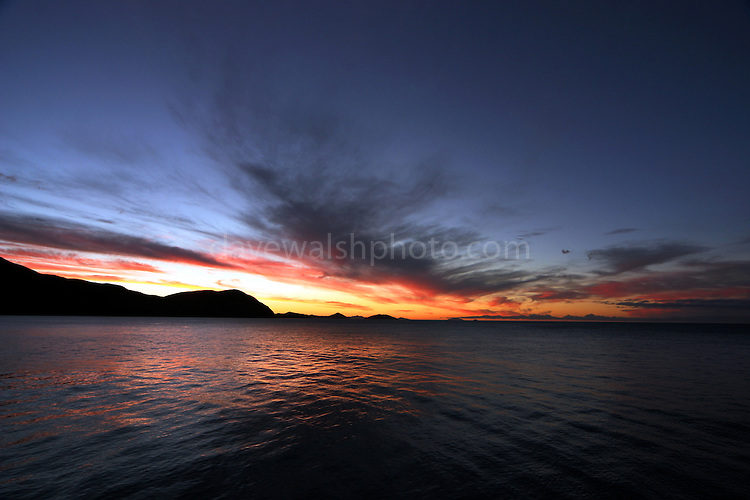Sunset over Port Gore, Marlborough Sounds, New Zealand. Port Gore is the famous last resting place of the  Soviet luxury cruise liner  Mikhail Lermontov, which sank on February 16th, 1986  while trying to navigate the narrow passage between Cape Jackson and  Lighthouse Rock.<br /> <br /> Port Gore was the also original site on which the Maori Rangitane<br /> iwi arrived in Marlborough.