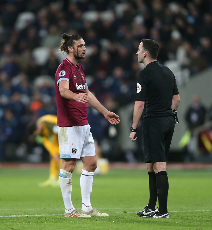 West Ham United's Andy Carroll has words with referee Christopher Kavanagh after sustaining a cut over his eye<br /> <br /> Photographer Rob Newell/CameraSport<br /> <br /> The Premier League - West Ham United v Brighton and Hove Albion - Wednesday 2nd January 2019 - London Stadium - London<br /> <br /> World Copyright © 2019 CameraSport. All rights reserved. 43 Linden Ave. Countesthorpe. Leicester. England. LE8 5PG - Tel: +44 (0) 116 277 4147 - admin@camerasport.com - www.camerasport.com