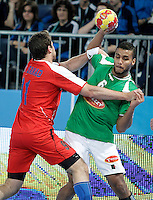 Algeria's Messaoud Berkous (r) and Egypt's Mohamed Hisham during 23rd Men's Handball World Championship preliminary round match.January 15,2013. (ALTERPHOTOS/Acero) /NortePhoto