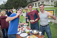"Team ""Justice League"", Zane Willing '15 (Superman t-shirt), Charles Deffarges '15 (Spider-Man costume) and Stefan Johnson '15 (gray tank top).  Occidental College students compete in the Iron Chef competition, sponsored by FEAST, in the AGC Quad on Oct. 31, 2014. Competitors were given ingredient options and a time limit to create a dish, which was judged by faculty and staff. (Photo by Marc Campos, Occidental College Photographer)"