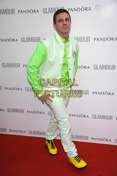 Jake Shears of Scissor Sisters.Women Of The Year 2012 - Glamour Awards, Berkeley Square, London, England..29th May 2012.full length white green jacket sleeves jeans denim yellow shoes.CAP/PL.©Phil Loftus/Capital Pictures.