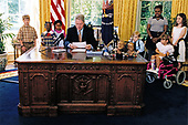 United States President Bill Clinton delivers his weekly radio address live from the Oval Office of the White House in Washington, DC on June 1, 1996.  In his remarks the President spoke of the &quot;national commitment that poor children, pregnant women, people with disabilities, and older Americans will not be denied health care simply because they can't afford it.&quot;<br /> Mandatory Credit: Ralph Alswang / White House via CNP