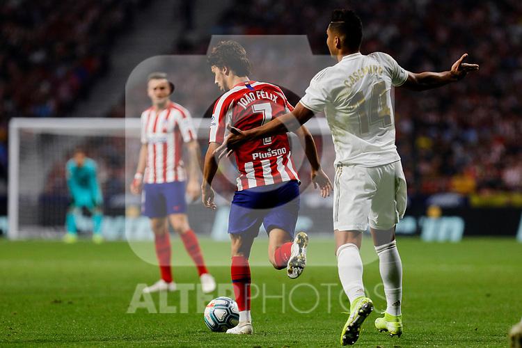 Joao Felix of Atletico de Madrid and Carlos Henrique Casimiro of Real Madrid during La Liga match between Atletico de Madrid and Real Madrid at Wanda Metropolitano Stadium{ in Madrid, Spain. {iptcmonthname} 28, 2019. (ALTERPHOTOS/A. Perez Meca)
