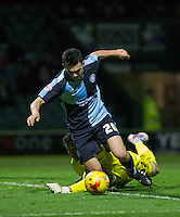 Luke O'Nien of Wycombe Wanderers goes down after a challenge by Chris Weale of Yeovil Town during the Sky Bet League 2 match between Yeovil Town and Wycombe Wanderers at Huish Park, Yeovil, England on 24 November 2015. Photo by Andy Rowland.