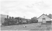 3/4 view of D&amp;RGW K-27 #456 hauling stock cars at depot in Ridgway.<br /> RGS  Ridgway, CO  Taken by Richardson, Robert W. - 9/16/1946