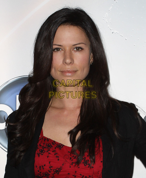 RHONA MITRA.Disney/ABC Television Group Press Junket held At The ABC Television Network Building, Burbank, California, USA..May 15th, 2010.headshot portrait jacket black red pattern print .CAP/ADM/KB.©Kevan Brooks/AdMedia/Capital Pictures.