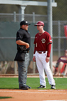 Boston College Eagles assistant coach Greg Sullivan talks with umpire Zach Tieche in between innings during a game against the Minnesota Golden Gophers on February 23, 2018 at North Charlotte Regional Park in Port Charlotte, Florida.  Minnesota defeated Boston College 14-1.  (Mike Janes/Four Seam Images)