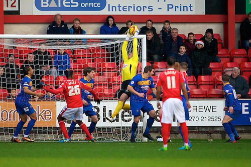 21.12.2013 Crewe, England. Shrewsbury Town goalkeeper Chris Weale makes a high save from the crossed ball during the League One game between Crewe Alexandra and Shrewsbury Town from the Alexandra Stadium.