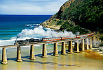 South Africa: Outeniqua Choo Tjoe steam train crossing tressel at mouth of Kaimans River on Indian Ocean near Wilderness in Western Cape