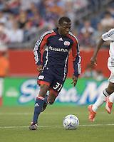 New England Revolution midfielder Sainey Nyassi (31) brings the ball forward. The New England Revolution tied DC United, 2-2, in Gillette Stadium on May 29, 2008.