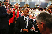 President Barack Obama looks up at the balcony as he walks back up the aisle at conclusion of his State of the Union address to a joint session of Congress on Capitol Hill in Washington, Tuesday, Jan. 12, 2016.<br /> Credit: Evan Vucci / Pool via CNP