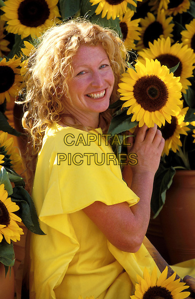 CHARLIE DIMMOCK.yellow, sunflowers, flowers, smiling.www.capitalpictures.com.sales@capitalpictures.com.©Capital Pictures.