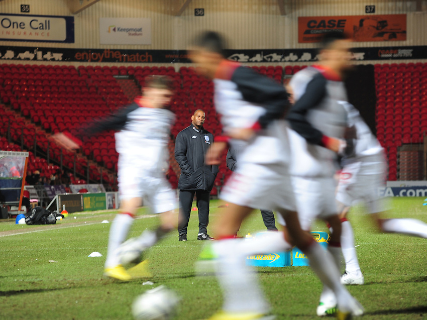 England's Head Coach Noel Blake watches over part of his team's warm-up routine..Football - U19 International Friendly - England v Denmark - Tuesday 5th February 2013 - Keepmoat Stadium - Doncaster..