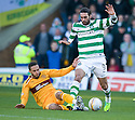 MOTHERWELL'S TOM HATELEY CHALLENGES CELTIC'S GEORGIOS SAMARAS.