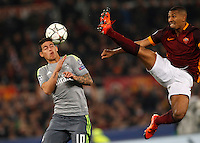 Calcio, andata degli ottavi di finale di Champions League: Roma vs Real Madrid. Roma, stadio Olimpico, 17 febbraio 2016.<br /> Real Madrid's James Rodriguez, left, and Roma's William Vainqueur fight for the ball during the first leg round of 16 Champions League football match between Roma and Real Madrid, at Rome's Olympic stadium, 17 February 2016.<br /> UPDATE IMAGES PRESS/Riccardo De Luca