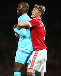 Bastian Schweinsteiger of Manchester United hugs West Ham's Angelo Ogbonna in frustration following a missed chance - Manchester United vs West Ham United - Barclay's Premier League - Old Trafford - Manchester - 05/12/2015 Pic Philip Oldham/SportImage