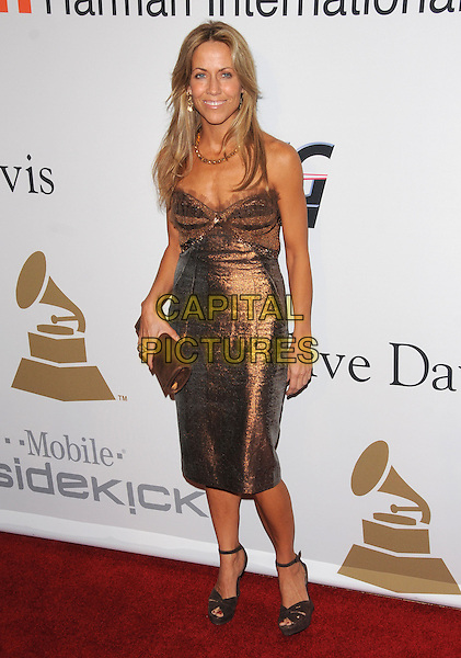 SHERYL CROW.The Clive Davis / Recording Academy Annual Pre- Grammy Party held at The Beverly Hilton Hotel in Beverly Hills, California, USA. .February 7th, 2009.full length brown bronze gold metallic dress clutch bag strapless .CAP/DVS.©Debbie VanStory/Capital Pictures.
