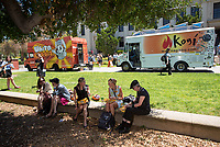 "Food conference attendees eat from food trucks Kogi and White Rabbit in the Academic Quad in front of Johnson Hall.<br /> Occidental College hosts the Oxy Food Conference, an annual meeting and conference for the Agriculture, Food and Human Values Society (AFHVS)/Association for the Study of Food and Society (ASFS). The event ran from June 14-17, 2017 and was organized by Oxy associate professor of sociology John Lang. This was the first time Oxy hosted this conference.<br /> More than 500 food scholars converged for one of the discipline's largest international conferences and the chance to discuss everything from sustainable agricultural and fisheries practices to the cultural significance of Basque-American ""picon punch.""<br /> (Photo by Marc Campos, Occidental College Photographer)"