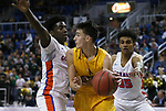 Bishop Gorman defenders William McClendon, left, and Jamal Bey pressure Bishop Manogue's Kolton Frugoli during the 4A NIAA state basketball championship game in Reno, Nev., on Friday, Feb. 23, 2018. Gorman won 62-41. Cathleen Allison/Las Vegas Review-Journal