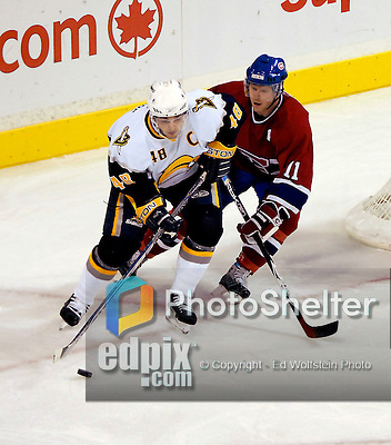 23 October 2006: Montreal Canadiens center from Finland, and team captain, Saku Koivu (11)  in action against Buffalo Sabres center, and team captain Daniel Briere (48), at the Bell Centre in Montreal, Canada on October 23, 2006. The Sabres defeated the Canadiens 4-1. Mandatory photo credit: Ed Wolfstein Photo.<br />  *** Editorial Sales through Icon Sports Media *** www.iconsportsmedia.com