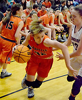 Westside Eagle Observer/MIKE ECKELS<br /> <br /> After receiving a handoff from team mate Shylee Morrison (15), Lady Lion Kaylan Chilton tries to get around Ariel Nix ( Pioneer 13) on her way to the basket during the Gravette-Gentry varsity girls conference contest in Gravette Jan. 7.