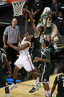 Michigan State Spartans Delvon Roe #10 blocks a layup by Malcolm Lee #3 during the second round game of the NCAA Basketball Tournament at St. Pete Times Forum on March 17, 2011 in Tampa, Florida.  The UCLA Bruins defeated the Michigan State Spartans 78-76.  (Mike Janes/Four Seam Images)
