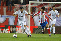 11.04.2012 MADRID, SPAIN - La Liga match played between At. Madrid vs Real Madrid (1-4) with hat-trick of Cristiano Ronaldo at Vicente Calderon stadium. The picture show Sami Khedira (German midfielder of Real Madrid) and Arda Turan (Turkish midfielder of At. Madrid)