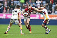 Wigan Warriors' Liam Marshall is tackled by Huddersfield Giants' Alex Mellor (left) and Danny Brough (right) <br /> <br /> Photographer Stephen White/CameraSport<br /> <br /> Betfred Super League Round 5 - Wigan Warriors v Huddersfield Giants - Sunday 19th March 2017 - DW Stadium - Wigan<br /> <br /> World Copyright &copy; 2017 CameraSport. All rights reserved. 43 Linden Ave. Countesthorpe. Leicester. England. LE8 5PG - Tel: +44 (0) 116 277 4147 - admin@camerasport.com - www.camerasport.com
