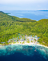 aerial view of a coastal village on Mansoear Island, aerial view of Raja Ampat Islands, West Papua, Indonesia, Pacific Ocean