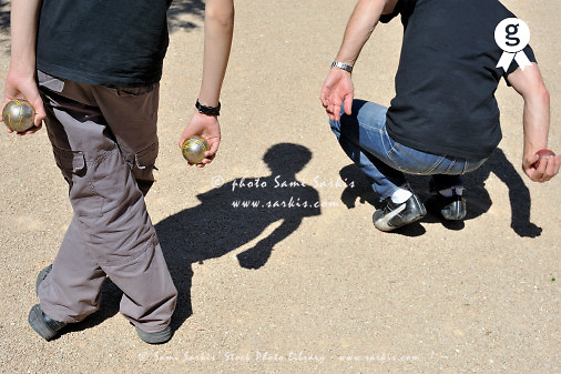 Man and teen boy playing french boules game (Licence this image exclusively with Getty: http://www.gettyimages.com/detail/84430627 )
