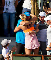 France, Paris, 04.06.2014. Tennis, French Open, Roland Garros, Maria Sharapova (RUS) climes in the tribune to celebrate with her coach Sven Groeneveld (NED) after defeating Halep in the final and wins Roland Garros<br /> Photo:Tennisimages/Henk Koster