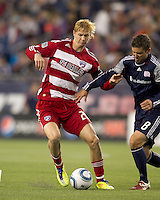 FC Dallas midfielder Brek Shea (20) battles New England Revolution midfielder Chris Tierney (8) for the ball. In a Major League Soccer (MLS) match, the New England Revolution defeated FC Dallas, 2-0, at Gillette Stadium on September 10, 2011.