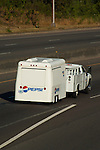 Chassis cab truck towing Pepsi trailer