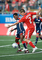 23 May 09: New England Revolution defender Emmanuel Osei #5 and Toronto FC midfielder Sam Cronin #2 in action during a game between the New England Revolution and Toronto FC..Toronto FC won 3-1.