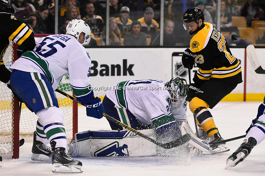 February 24, 2015 - Boston, Massachusetts, U.S. - Vancouver Canucks goalie Eddie Lack (31) makes a save during the first period of the NHL match between the Vancouver Canucks and the Boston Bruins held at TD Garden in Boston Massachusetts. Eric Canha/CSM