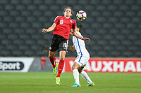 Nina Burger (SC Sand) of Austria Women wind the aerial battle during the Women's Friendly match between England Women and Austria Women at stadium:mk, Milton Keynes, England on 10 April 2017. Photo by PRiME Media Images / David Horn.
