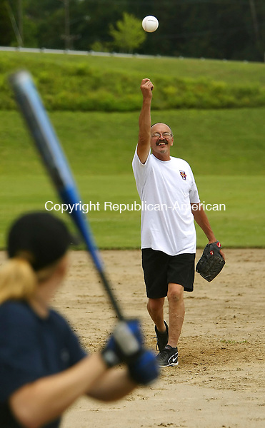 MIDDLEBURY, CT, 23 July 2006- 072306BZ01- Paul Townsend, an honorary member of the Middlebury Volunteer Fire Department, pitches to Watertown firefighter Christina Palombo during a game at Meadowview Park in Middlebury Sunday afternoon.<br /> Jamison C. Bazinet Republican-American