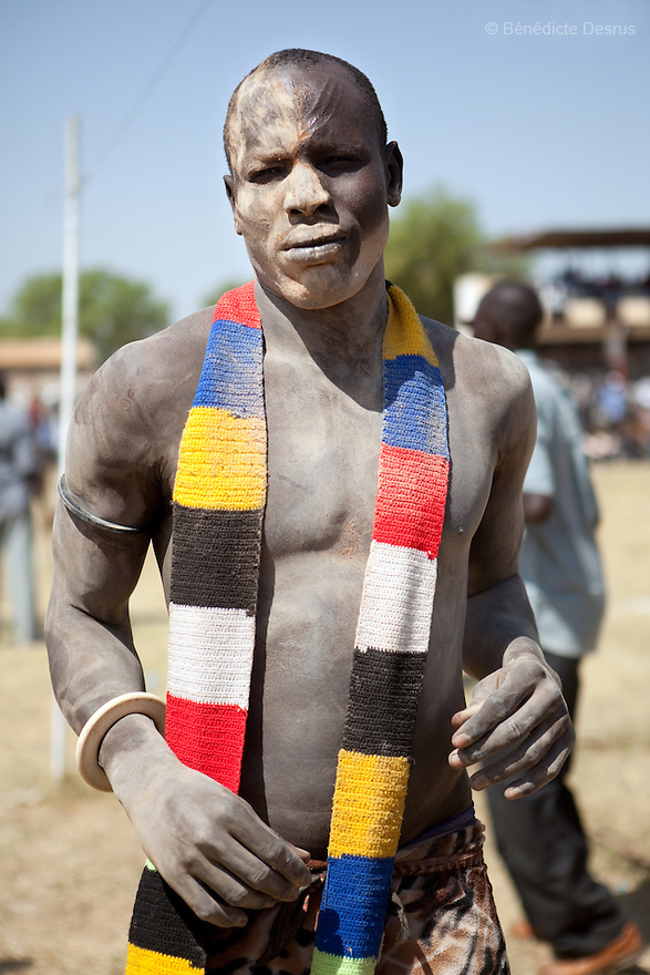 18 december 2010 - Juba, Southern Sudan - A wrestler of the Mundari tribe from Central Equatoria State before the final of South Sudan's first commercial wrestling league between his tribe and the Dinka wrestlers from Bor, Jonglei State at Juba Stadium. The matches attracted large numbers of spectators who sang, played drums and danced in support of their favorite wrestlers. The match organizers hoped that the traditional sport would bring together South Sudan's many different tribes. Photo credit: Benedicte Desrus