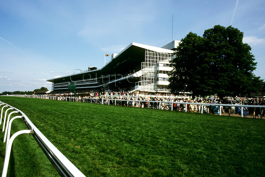 View of the grandstand at a racecourse from opposite side of railings