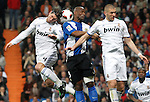 Real Madrid's Sergio Ramos (l) and Karim Benzema (r) and Hercules' Noe Pamarot during La Liga match.March 12,2011. (ALTERPHOTOS/Acero)