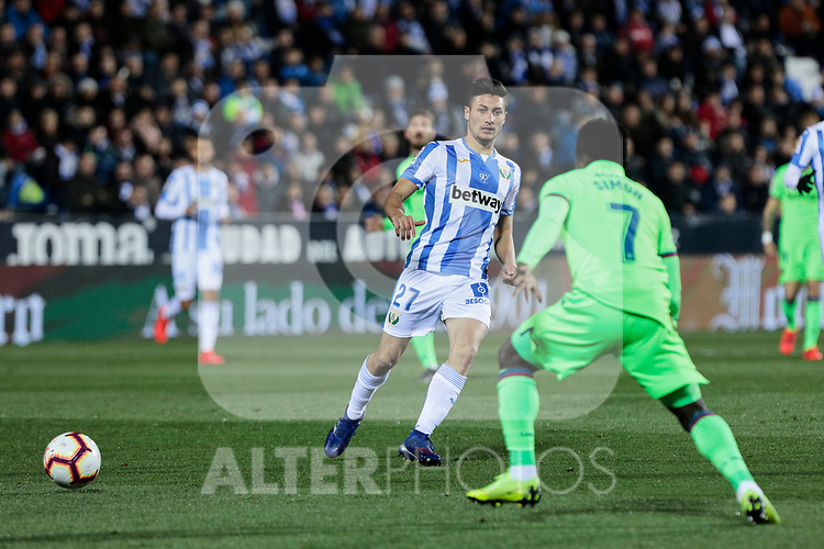 CD Leganes's Oscar Rodriguez and Levante UD's Moses Daddy-Ajala during La Liga match between CD Leganes and Levante UD at Butarque Stadium in Leganes, Spain. March 04, 2019. (ALTERPHOTOS/A. Perez Meca)