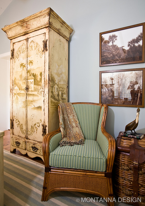 Wicker, rattan, and a distressed finish armoire with sepia toned photography complete the vintage Florida vignette