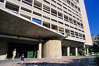 Woman and her son entering Unité d'Habitation (designed by the architect Le Corbusier), Marseille, France.