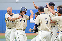 13 April 2008: Florida International second baseman Ryan Mollica (7) is met by teammates after scoring a run in the third inning to give FIU the lead during the Middle Tennessee 11-8 victory over FIU in 10 innings at University Park Stadium in Miami, Florida.