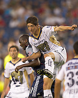 New England Revolution forward Kheli Dube (11) and Pumas UNAM defender Mario Antonio Palacios (3) in the mix on a corner kick. The New England Revolution defeated Pumas UNAM in SuperLiga group play, 1-0, at Gillette Stadium on July 14, 2010.