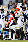 18 October 2014: Georgia Tech's D.J. White (28) flips UNC's Bug Howard (84) upside down while tackling him. The University of North Carolina Tar Heels hosted the Georgia Tech Yellow Jackets at Kenan Memorial Stadium in Chapel Hill, North Carolina in a 2014 NCAA Division I College Football game. UNC won the game 48-43.