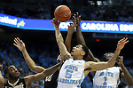 20 January 2016: North Carolina's Marcus Paige (5) and Theo Pinson (1) challenge for rebound against Wake Forest's John Collins (20) and Codi Miller-McIntyre (0). The University of North Carolina Tar Heels hosted the Wake Forest University Demon Deacons at the Dean E. Smith Center in Chapel Hill, North Carolina in a 2015-16 NCAA Division I Men's Basketball game. UNC won the game 83-68.