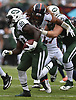 Isaiah Crowell #20 of the New York Jets carries upfield during nn NFL game against the Denver Broncos at MetLife Stadium in East Rutherford, NJ on Sunday, Oct. 7, 2018.